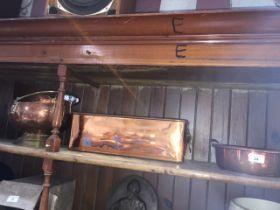 A copper pot with brass handles, a copper planter with brass lion's heads handles and a copper and