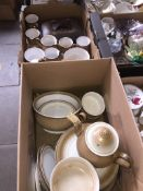 Two boxes containing Denby dinnerware