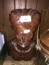 A Balinese carved wooden head.