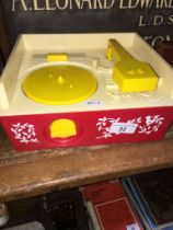 A vintage Fisher Price Music Box Record Player with discs.