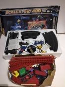 scalextric 400 set and a box containing a vintage plastic train set