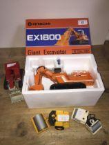 An Hitachi EX1800 Giant Excavator model in box, an Ingersoll-rand SP-60 model, an Ingersoll-rand