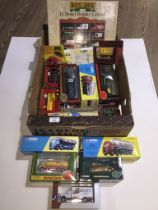 A box of boxed cars including Corgi Classics, Gilbow first editions, Matchbox Models of