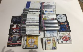A box of over 60 computer games including Playstation 2, PS3, PS4, Nintendo DS.