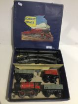 A Hornby 0 gauge clockwork goods train and 2 open waggons set with key