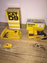 A CAT D9 Track-Type Tractor model in box and a Demac Road Finisher model in box