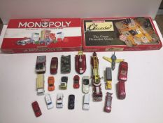 A box containing diecast toys, Cluedo and a monopoly board games