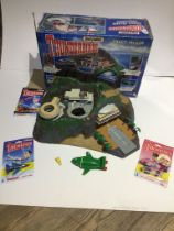 A Matchbox Thunderbirds Tracy Island with electronic rocket sounds and voices, in original box. Also