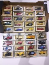 A box of 36 model vehicles, all boxed, most Lledo