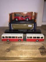 A Kyosho Triumph TR3A (red) 1:18 model in box and a Volvo B 10 M.Ledbuss model in box