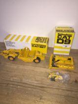 A CAT D9 Track-Type Tractor model in box and a CAT627 Push-Pull Scraper model in box