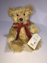 A Steiff Limited Edition Celebration Teddy Bear (unboxed) wearing embroidered ribbon 1880-2005 and