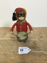 A Schuco patent drumming monkey clockwork toy, with makers mark to foot, no Key, H 11cm