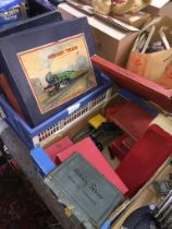 A box of Hornby 0 gauge accessories (many in original boxes) and 3 empty boxes of Hornby clockwork