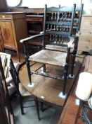 An 18th century oval joined oak gate leg table with pad feet, together with four spindle back and