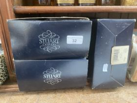 A set of 6 Stuart crystal wine glasses in boxes.