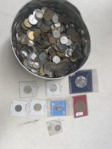 A tin of world coins