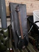 A Yamaha electric bass guitar and hard case.