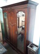 An Edwardian inlaid mahogany wardrobe, width 182cm, depth 60cm and height 215cm