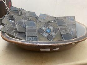 A salt glazed dish and a quantity of leaded glass panels.