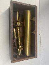 An antique brass telescope in wooden case.