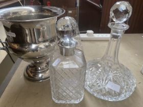 A silver plated ice bucket or campana urn form, together with two decanters.