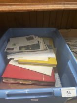 A box of stamp albums and covers
