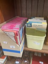Two boxes of ordinance survey maps and road maps