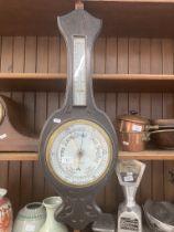An oak cased barometer