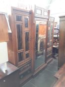 A late Victorian Aesthetic Movement walnut and coromandel wardrobe with Japanned brass panels and