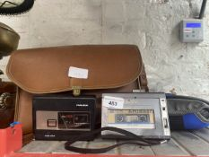 A Philips portable tape recorder type EL 3586, a Sony Walkman with headphones, a Saisho TR35 voice