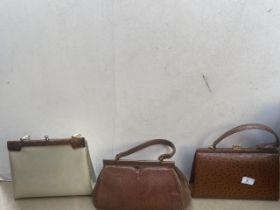 3 vintage ladies handbags to include lizard skin.