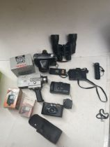 A box of cameras and related items to include Zenit, Pentax, a pair of binoculars, a Super 8 cine