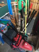 A Sovereign electric lawn mower, lawn edger, a lopper, spade, fork, couple of saws, Hozelock hose