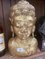 A wooden gilt Indonesian figure.