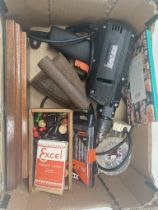 A box of miscellaneous to include electric drill with bits, playing cards, chess pieces, small glass