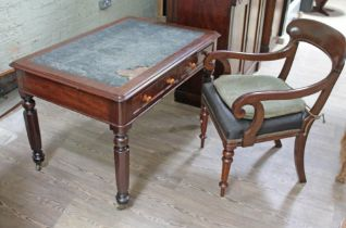 A Victorian mahogany two drawer library table together with a Regency mahogany armchair.