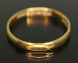 A hallmarked 22ct gold wedding band, wt. 2.92g, size R.