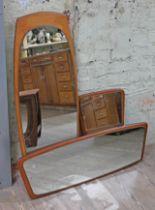 A group of three retro teak framed mirrors.