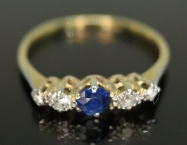 A five stone diamond and sapphire ring, the central stone weighing approx. 0.20 carats, total