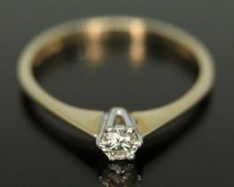 A hallmarked 9ct gold single stone diamond ring, the round brilliant cut diamond weighing approx.