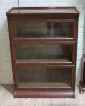 An early 20th century oak sectional bookcase, width 87cm, depth 35cm & height 122cm.