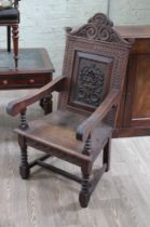 A 19th century carved oak Wainscot style armchair.