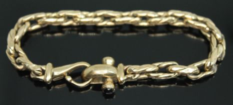 A 9ct gold bracelet, the clasp set with two sapphire cabochons, 9ct gold import marks, length
