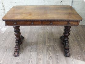 A George III Regency period rosewood two drawer library table in the manner of Gillows with beaded