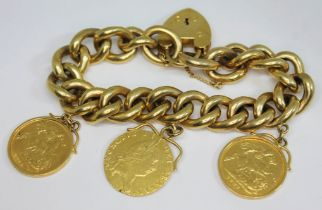 An early 20th century charm bracelet with two half sovereigns 1902 & 1914 and a 1793 half guinea,