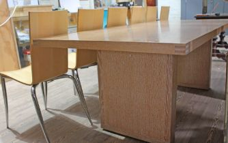 A B&B Italia Apta dining table designed by Antonio Citterio, together with six Olly Tango chairs