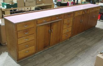 A pair of 1950s light oak kitchen units, patterned melamine tops, one with pull out slide and