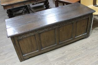 A joined oak coffer, circa 1700, the interior fitted with candle box and two drawers, length