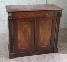 A 19th century mahogany cabinet, two drawers with lion mask handles either side, lower cabinet,